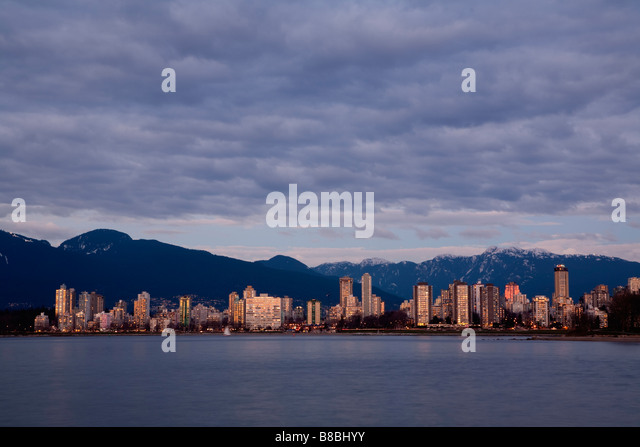 Downtown Vancouver skyline and the North Shore Mountains Vancouver British Columbia Canada - Stock Image