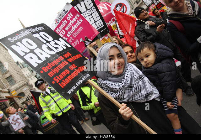 London, UK. March 18, 2017: A Muslim mother and her child take part in the Stand Up To Racism demonstration for - Stock Image