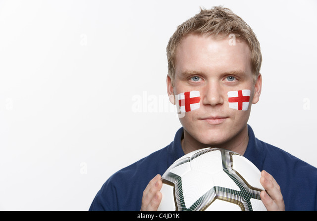 Young Male Football Fan With St Georges Flag Painted On Face - Stock Image