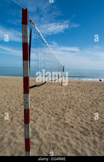 Netball Beachball net on a tropical beach with perspective - Stock Image