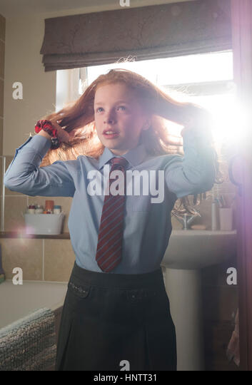 A little girl getting ready for junior school. - Stock Image