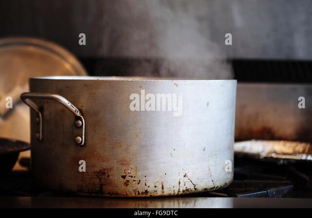 Close-Up Of Steam Coming Out From Metallic Container - Stock Image