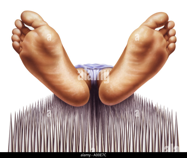 fakir nails bed with feet close-up - Stock-Bilder