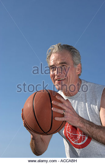 man about to shoot a basketball - Stock Image