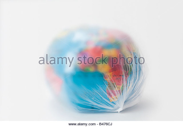 A plastic bag covering planet earth - Stock Image