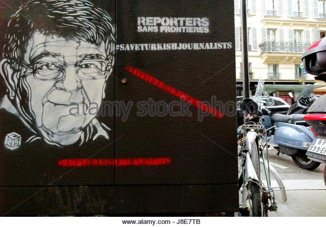 Paris, France. 28th May, 2017. Portrait of an arrested journalist in Turkey is painted on a wall in Paris, France - Stock Image