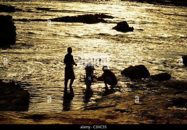 Democratic Republic of Congo in January 2011.Washin motorbike in Epulu river - Stock-Bilder