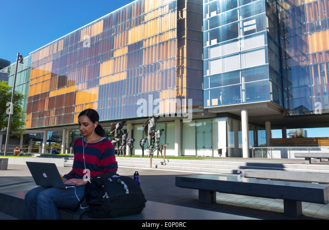 Sydney Australia NSW New South Wales University of Sydney education campus student woman Apple notebook New Law - Stock Image