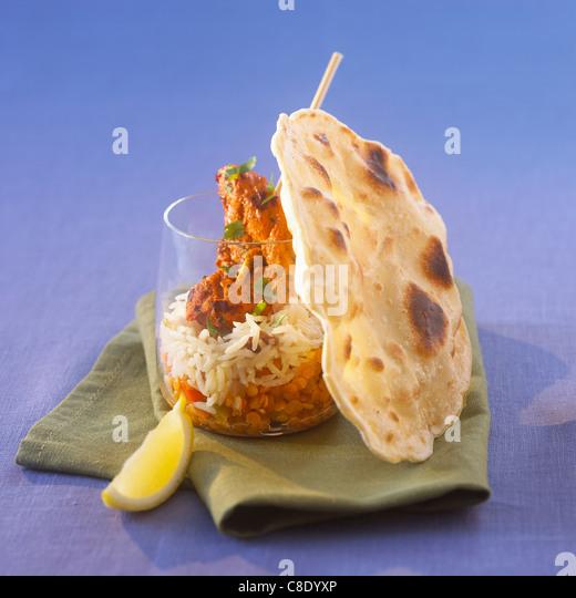Chicken tandoori with orange lentils and chapati - Stock Image