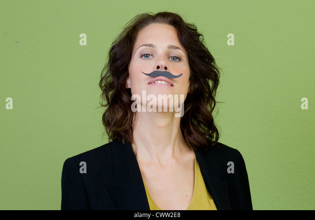 Woman wearing fake mustache - Stock Image