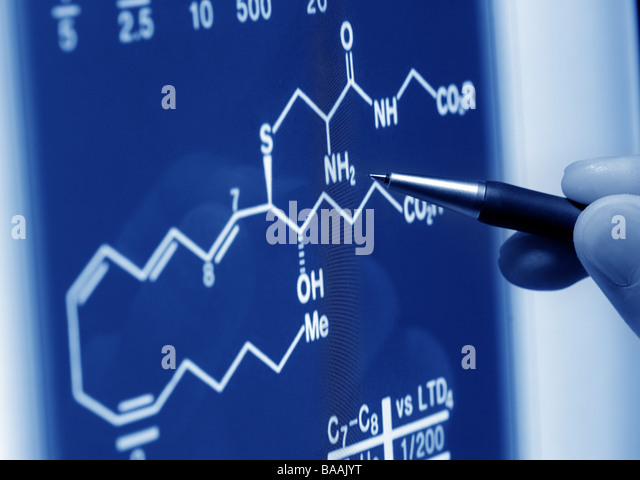 analyzing chemistry formula on screen - Stock Image