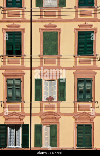 Shuttered windows of apartments - Stock Image