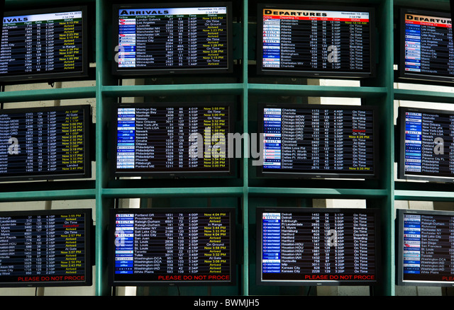 Flight Arrivals and Departures boards at Orlando International Airport, Florida, USA - Stock-Bilder