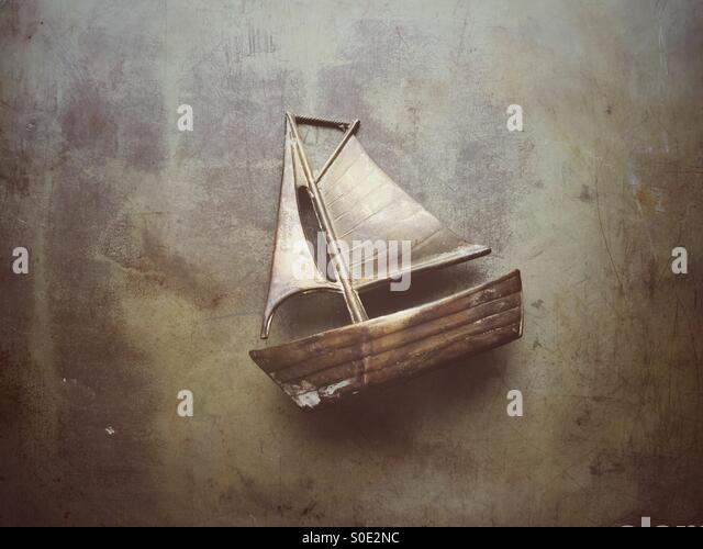 Old metal sailing boat model - Stock Image