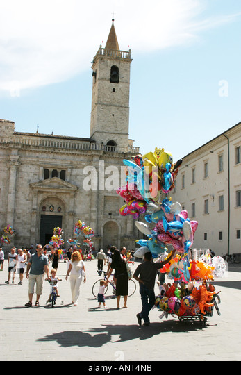 Steeple of the cathedral in Ascoli Piceno with balloons being sold in the foreground Le Marche Italy - Stock Image