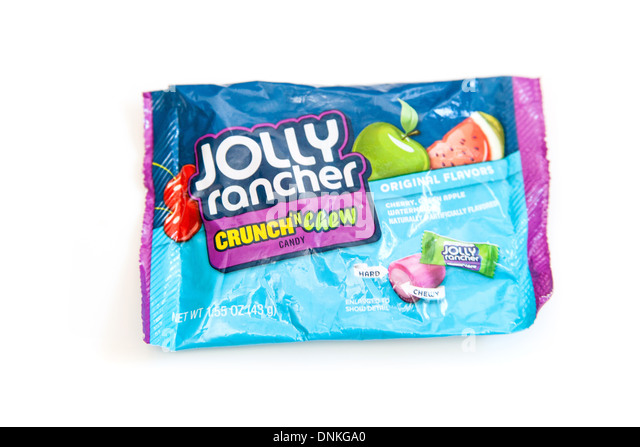 Packet of Jolly Rancher sweets or candy isolated on a white studio background. - Stock Image
