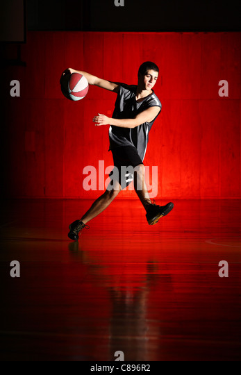 Basketball run on red background - Stock Image