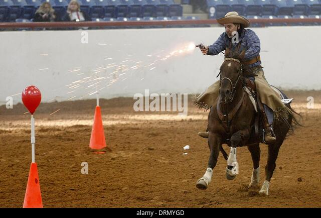 Fort Worth, Texas, USA. 29th Jan, 2014. Bobby Wilbanks on Docs Leo Dandy competes in mounted shooting at Justin - Stock Image