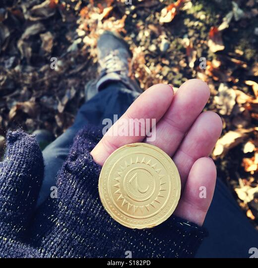 Chocolate coin on a country walk - Stock-Bilder