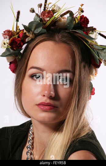 girls portrait, pretty, beauty, beautiful teenager, floral, fashion, fashion shoot, studio shoot, floral headband, - Stock Image