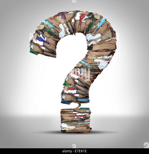 Recycle Cardboard Paper Questions and recycling cardboard packaging concept with stacks of compressed corrugated - Stock Image