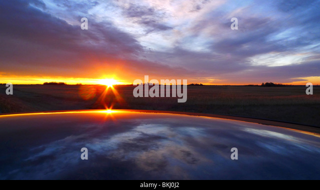 Canadian sunrise rising over the rural horizon. - Stock Image