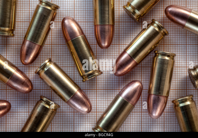 9mm cartridges on 1mm square graph paper - Stock Image