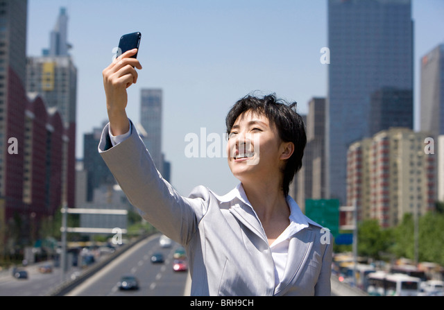 Businesswoman in an urban scene - Stock Image