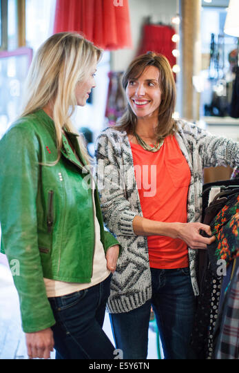 Women clothes shopping together - Stock Image