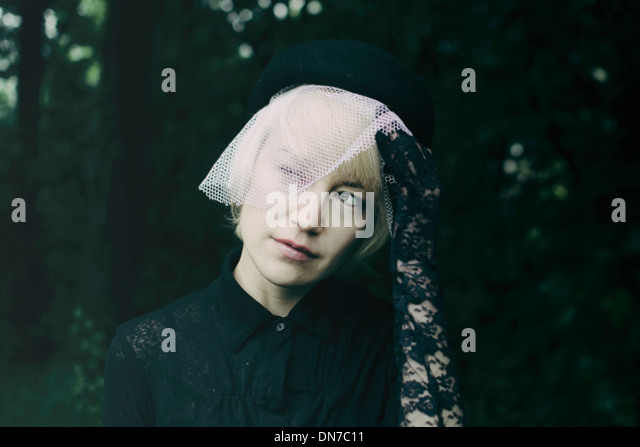 Woman wearing outfit for funeral - Stock Image