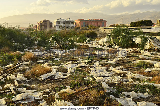 Plastics from greenhouses land pollution contamination, Almeria Southern Spain Europe - Stock Image