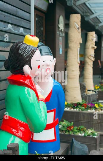 Asia, Republic of Korea, South Korea, Seoul statue of traditional couple - Stock Image