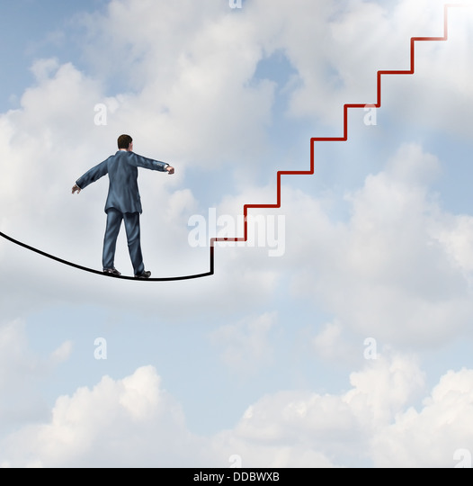 Risk solutions and adapting to change as a business idea with a businessman walking on a dangerous high wire tightrope - Stock Image
