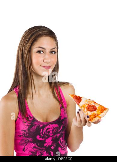 teenage girl holding a slice of pizza - Stock-Bilder