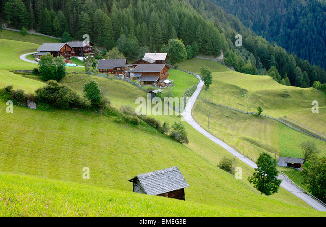 Europe, Austria, Road passing by farmhouses - Stock Image