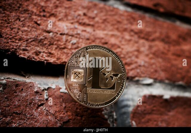 digital-currency-physical-gold-litecoin-coin-on-the-brick-wall-jjh0th.jpg