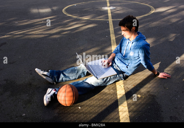 youth using laptop outdoors - Stock-Bilder