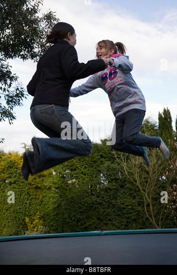 teenage girls on trampoline