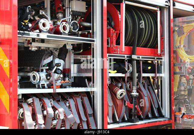 fire hoses on board a fire engine - Stock Image