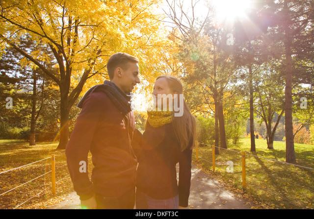Young romantic couple in autumn park, Vienna, Austria - Stock Image