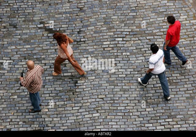Puerto Rico Old San Juan Calle Tetuan blue adoquine cobblestones male female pedestrians - Stock Image
