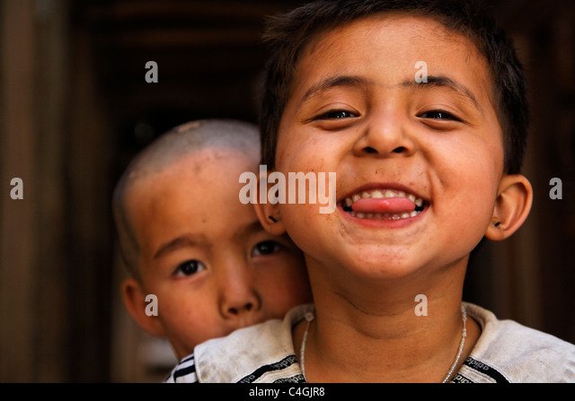 China - Xinjiang Province - Kashgar - cheeky children in the old town - Stock Image
