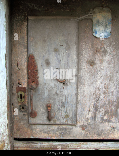 aged wood doors weathered vintage architecture detail - Stock Image