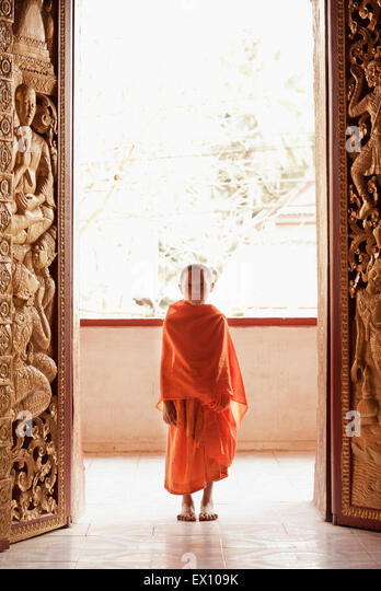 A portrait of a 12-year-old novice monk at Wat Manoran  Luang Prabang Laos - Stock Image