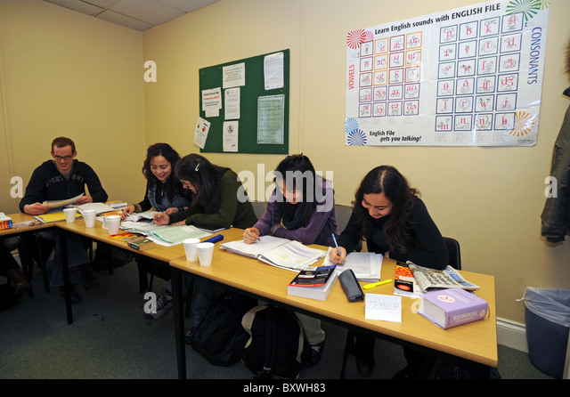 Foreign students learning English in a language school in Brighton - Stock Image