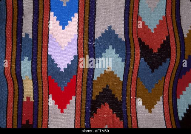 Ecuador Saquisili Market Otavalo Cotopaxi Chibuleos Indigenous natives blanket detail for sale fabric - Stock Image