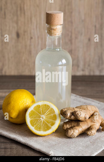 Lemon and Ginger Detox Drink in a Closed Bottle - Stock Image