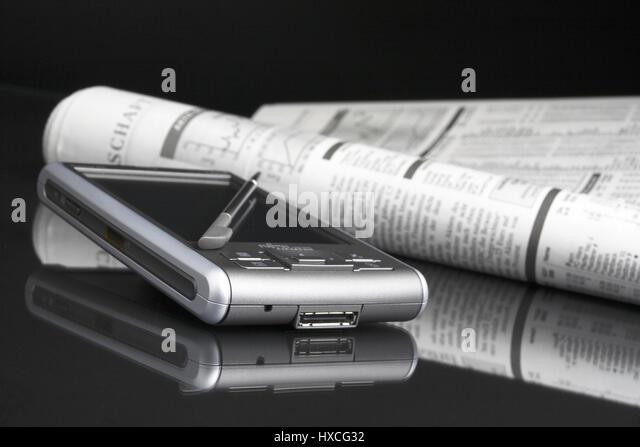 PDA with newspaper, PDA mit Zeitung - Stock-Bilder