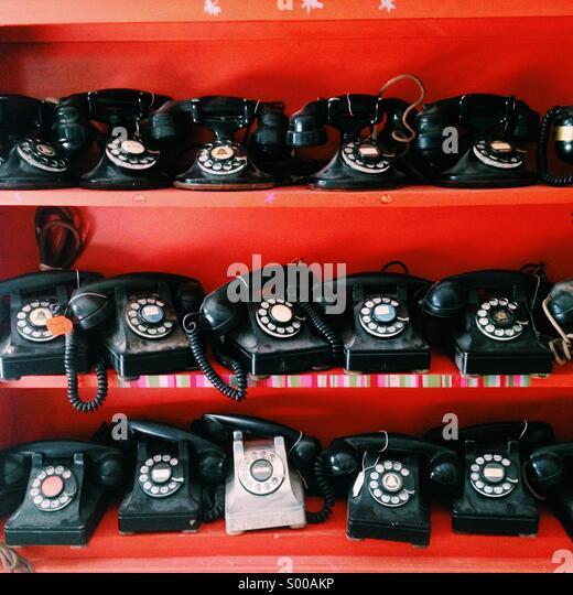 Rows of antique telephones - Stock Image