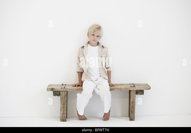 Portrait of young boy on a bench - Stock Image